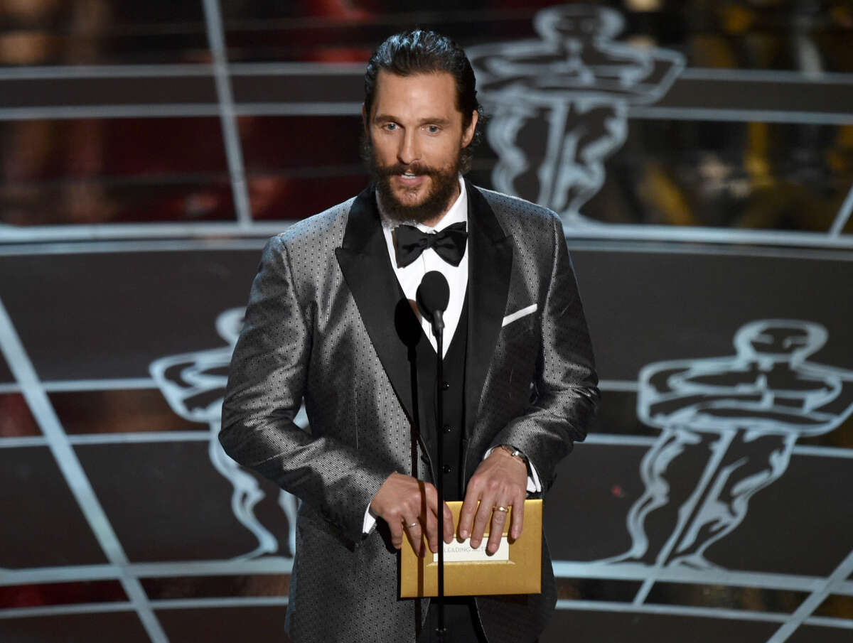 Matthew McConaughey presents the award for best actress in a leading role at the Oscars on Sunday, Feb. 22, 2015, at the Dolby Theatre in Los Angeles. (Photo by John Shearer/Invision/AP)