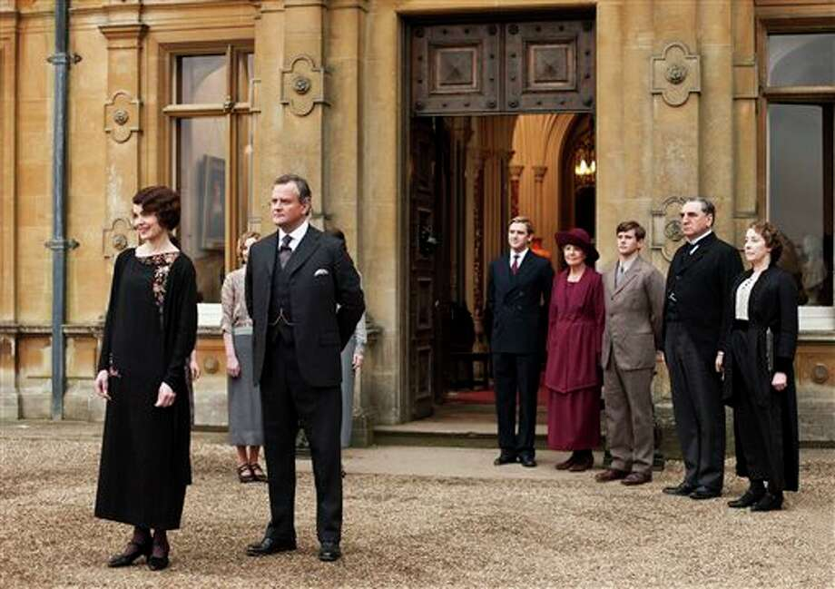 "This undated publicity photo provided by PBS shows, from left, Elizabeth McGovern as Lady Grantham, Hugh Bonneville as Lord Grantham, Dan Stevens as Matthew Crawley, Penelope Wilton as Isobel Crawley, Allen Leech as Tom Branson, Jim Carter as Mr. Carson, and Phyllis Logan as Mrs. Hughes, from the TV series, ""Downton Abbey."" It was reliably delicious and also pretty deadly in its third season, which began last January. Lovely Lady Sybil died in childbirth. Then, in the season conclusion, Matthew Crawley, heir to Downton and Lady Mary's beloved, perished in a car crash, leaving her a widowed mother. Hankies were sopping as viewers faced a long wait for Season 4. (AP Photo/PBS, Carnival Film & Television Limited 2012 for MASTERPIECE, Nick Briggs) Photo: Nick Briggs / PBS"