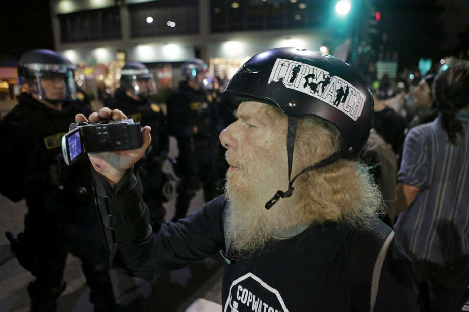 A protester films California Highway Patrol officers on University Avenue in Berkeley on Monday, December 8, 2014.  Photo: Terray Sylvester