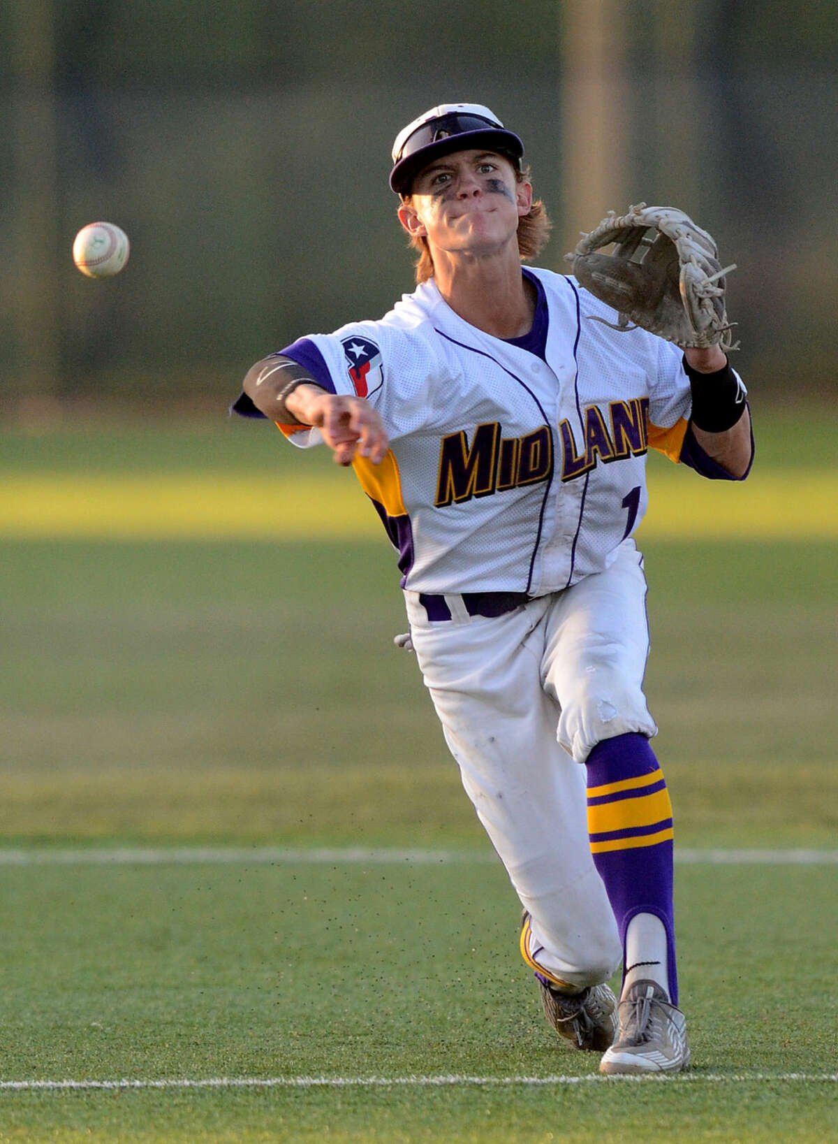 Midland High's Jaxon Hallmark throws to first base for an out against Arlington Lamar in game three of the 6A bi-district playoff on Saturday, May 9, 2015 at Christensen Stadium. James Durbin/Reporter-Telegram