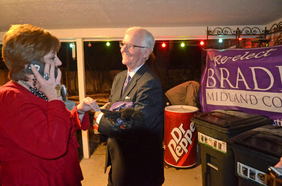 County Judge Mike Bradford and Tax Assessor Collector Karen Hood celebrate election victories during an election watch party Tuesday at the Bradford residence. James Durbin/Reporter-Telegram Photo: JAMES DURBIN
