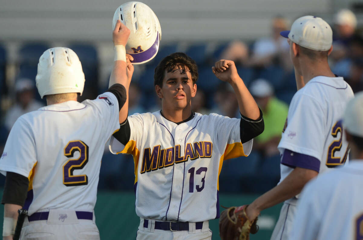 Midland High's Jacob Mata celebrates with teammates after scoring a run against Arlington Lamar in game three of the 6A bi-district playoff on Saturday, May 9, 2015 at Christensen Stadium. James Durbin/Reporter-Telegram