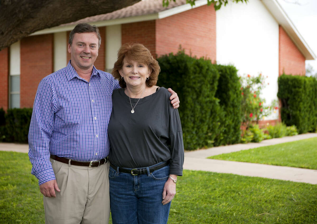 Pastor Steven Knisely and his wife Lisa in portrait Tuesday, April, 28, 2015, outside the Christian Church of Midland. James Durbin/Reporter-Telegram