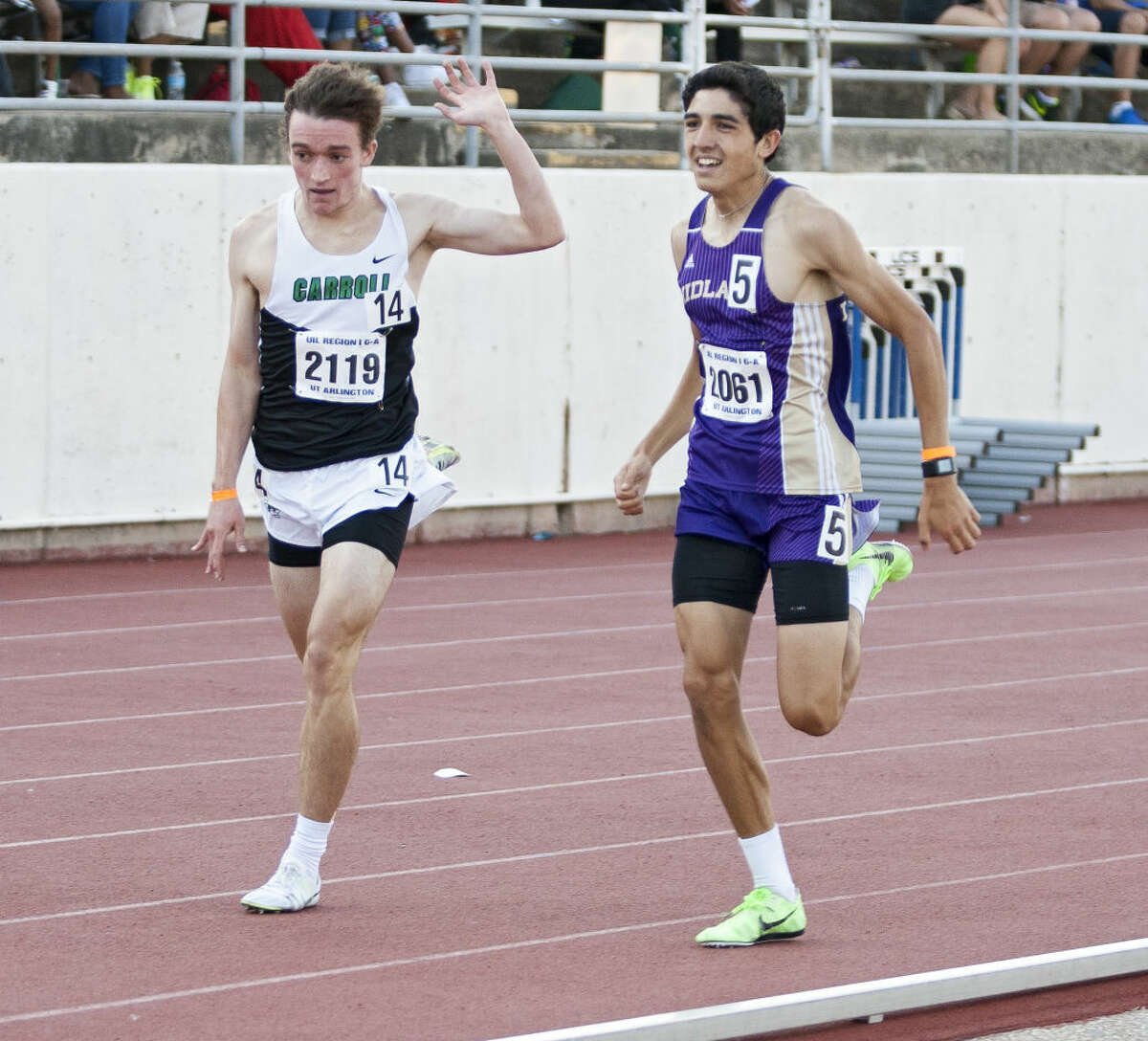 Midland junior Bryce Hoppel passes Southlake Carroll's Johnny Kemps at the end of the 1600M run during the UIL 6A Region 1/5A Region 2 Track and Field Championship on Saturday at Maverick Stadium in Arlington. Hope finished in second with a 4:18.12 run.