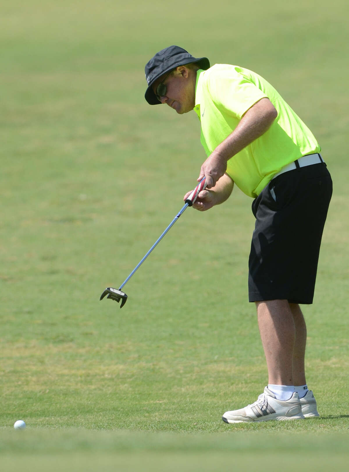 Michael Pruitt hits onto the green during the Stampede Golf Tournament on Friday, May 15, 2015, at Ranchland Hills Golf Club. James Durbin/Reporter-Telegram