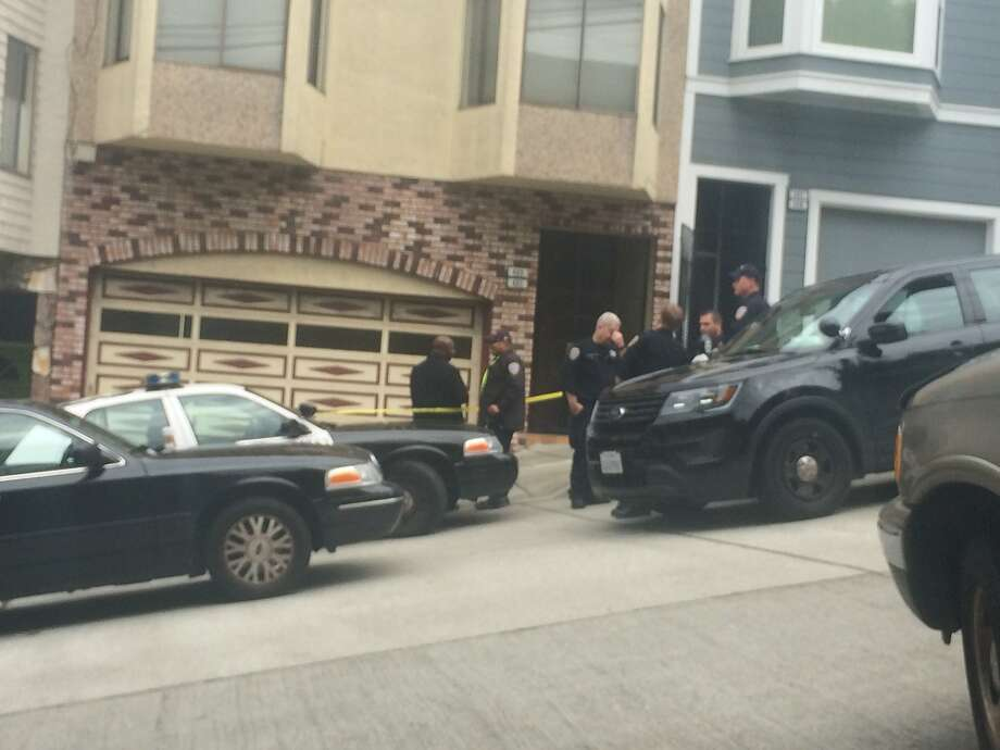 San Francisco police cordon off a home in the 400 block of Arkansas Street in the Potrero Hill neighborhood as they investigate the fatal stabbing of a woman. Photo: Jenna Lyons