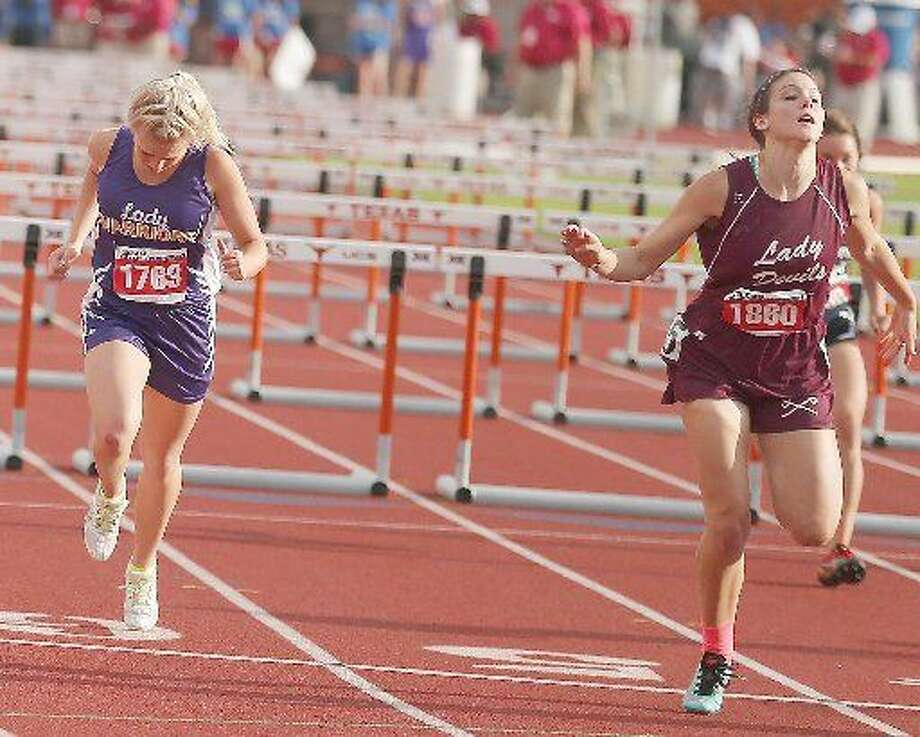 Rankin hurdler Abigail Davis, right, leans at the finish line to capture second place at the Conference 1-A State Track and Field Championships Friday in Austin. Photo: Wade H. Clay