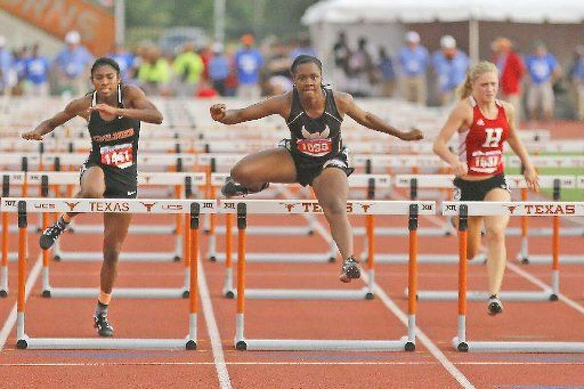 Andrews hurdler Oceana Ridge, center, takes the lead over the final hurdle to claim first place in the girls Class 4A 100 meter finals.