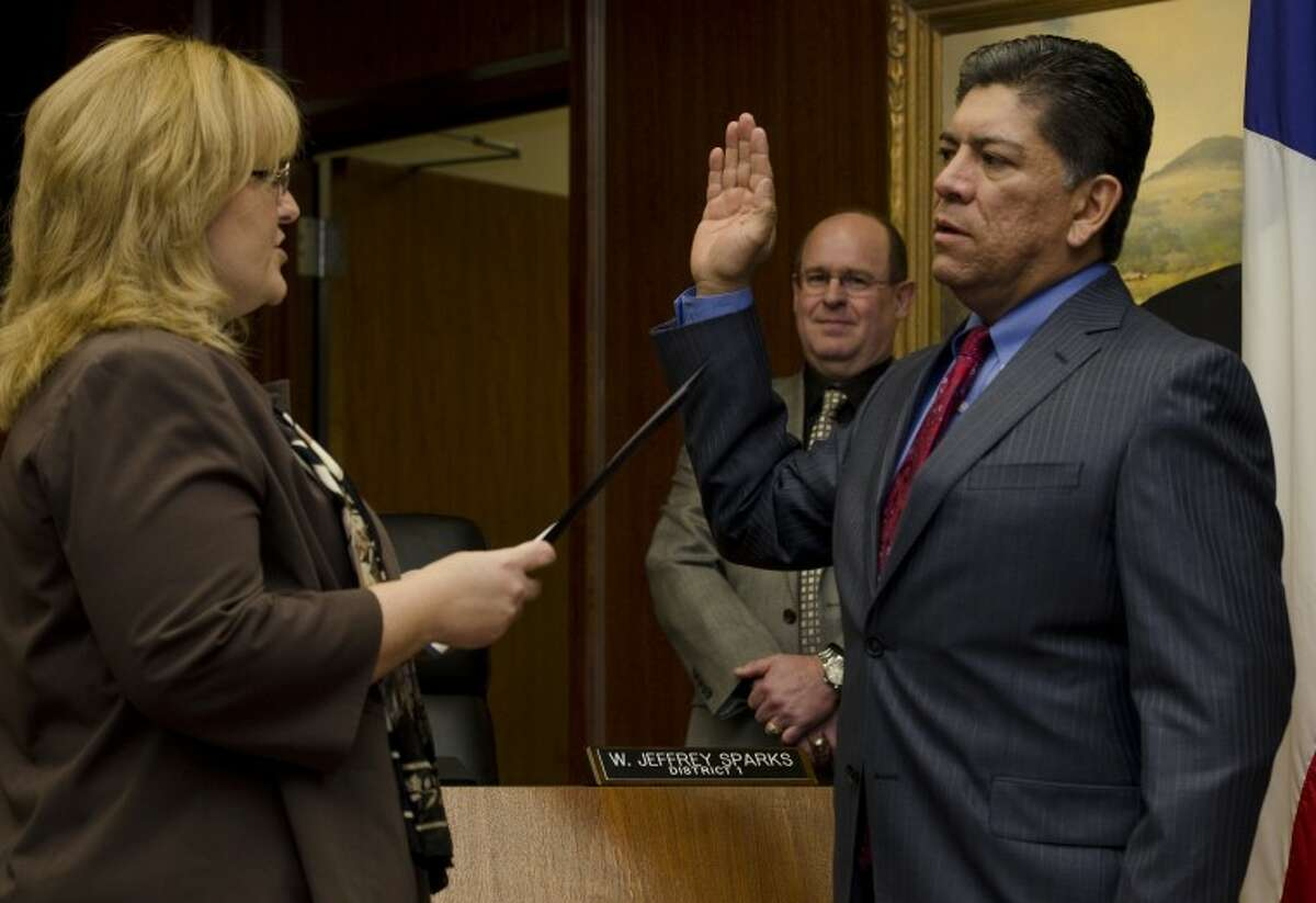 (File Photo) Jerry Morales takes his oath of office Monday as city secretary Amy Turner administers the oath to new and returning council members. Tim Fischer\Reporter-Telegram