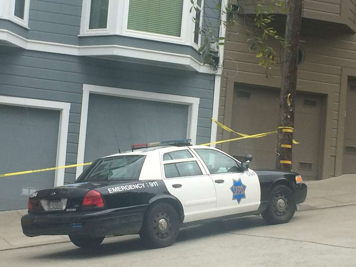 San Francisco police cordoned off a home in the 400 block of Arkansas Street in the Potrero Hill neighborhood as they investigated a fatal stabbing of a woman.