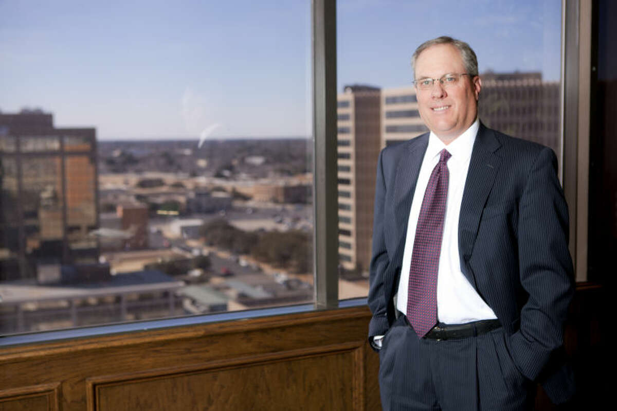 Ken Burgess, past chair of the American Bankers Association's Community Bankers Council, in portrait Feb. 12, 2014 in his downtown Midland office. James Durbin/Reporter-Telegram
