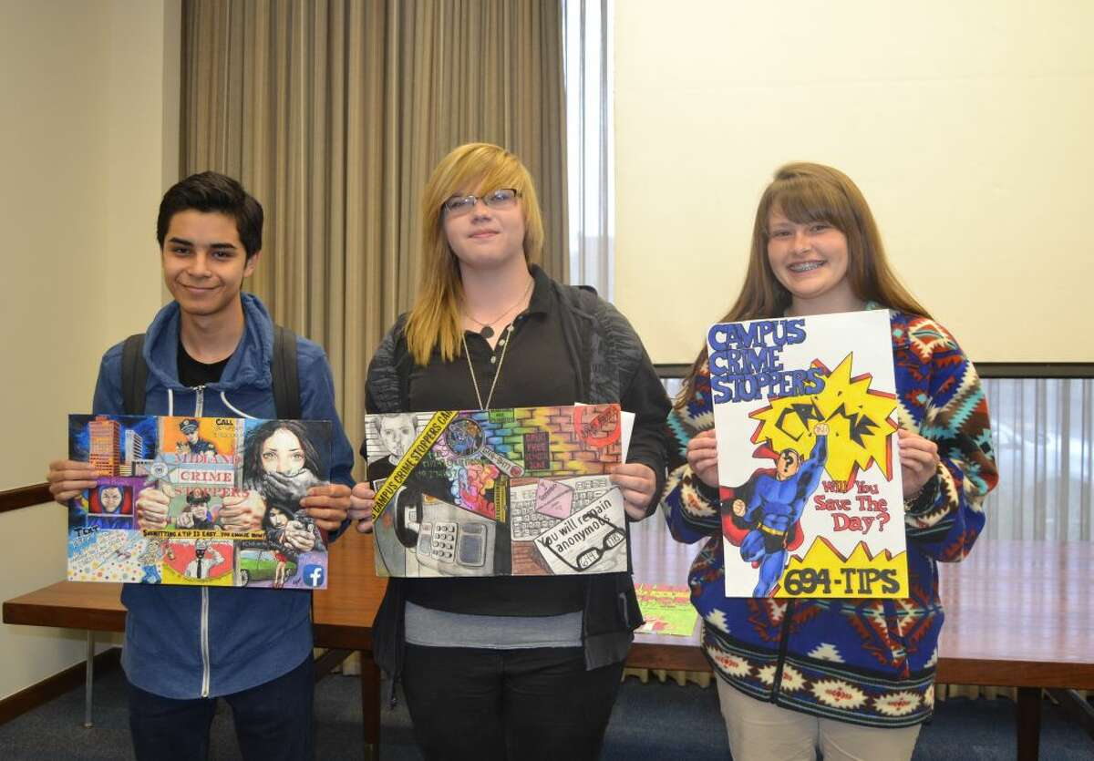 Winners in the high school category of the Crime Stoppers poster contest are Mikey Jacquez, first place, from left; Madison Ottesen, second place and Katherine Klassen, third place.