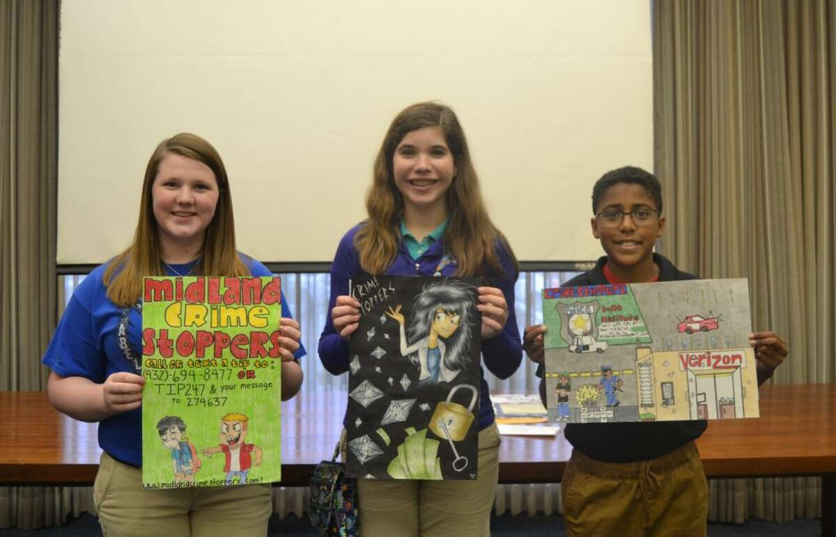 Winners in the junior high school category of the Crime Stoppers poster contest are Sarah Stanaland, first place, from left; Allison Gamertsfelder, second place, and C.J. Byrd, third place.