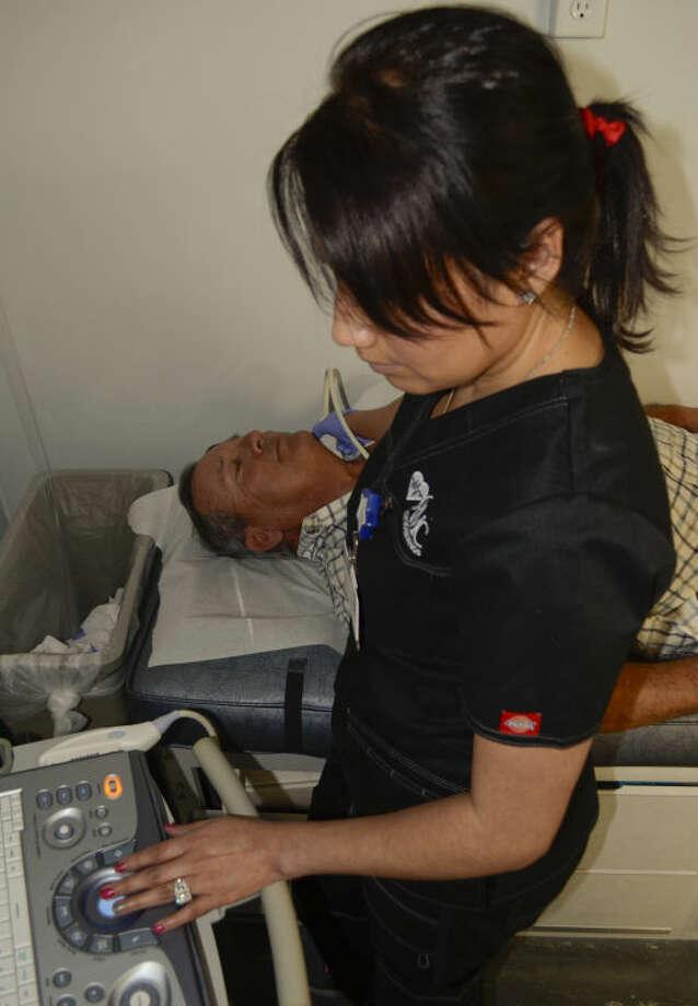 Sendra Luna uses an ultrasound to scan Sonny Turner's arteries Feb. 25, 2014 in the ORMC mobile screening bus. Tim Fischer\Reporter-Telegram Photo: Tim Fischer