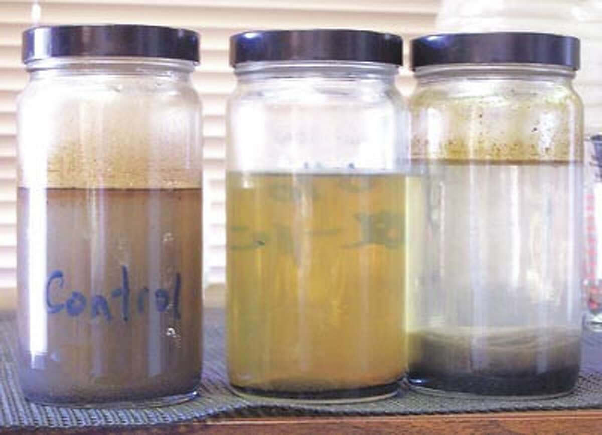 Super Scrubber now offers a chemical-only treatment for produced water that cuts costs in half compared to traditional machinery-based methods. In this photo, the jar on the left contains raw produced water. In the center is water cleaned by a popular current method, and on the right is water treated by Super Scrubber's new option. To learn more call John May or Billy Rose at 580-4806.