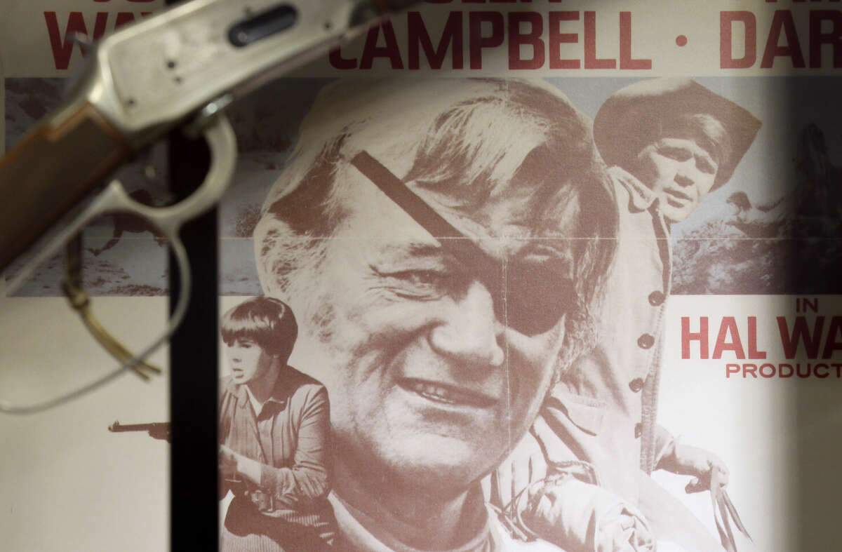 A movie poster from True Grit is shown in a display case in the John Wayne Museum, Thursday in Winterset, Iowa. Tuesday would have been the Hollywood legend's 108th birthday. The Texas Legislature declared it