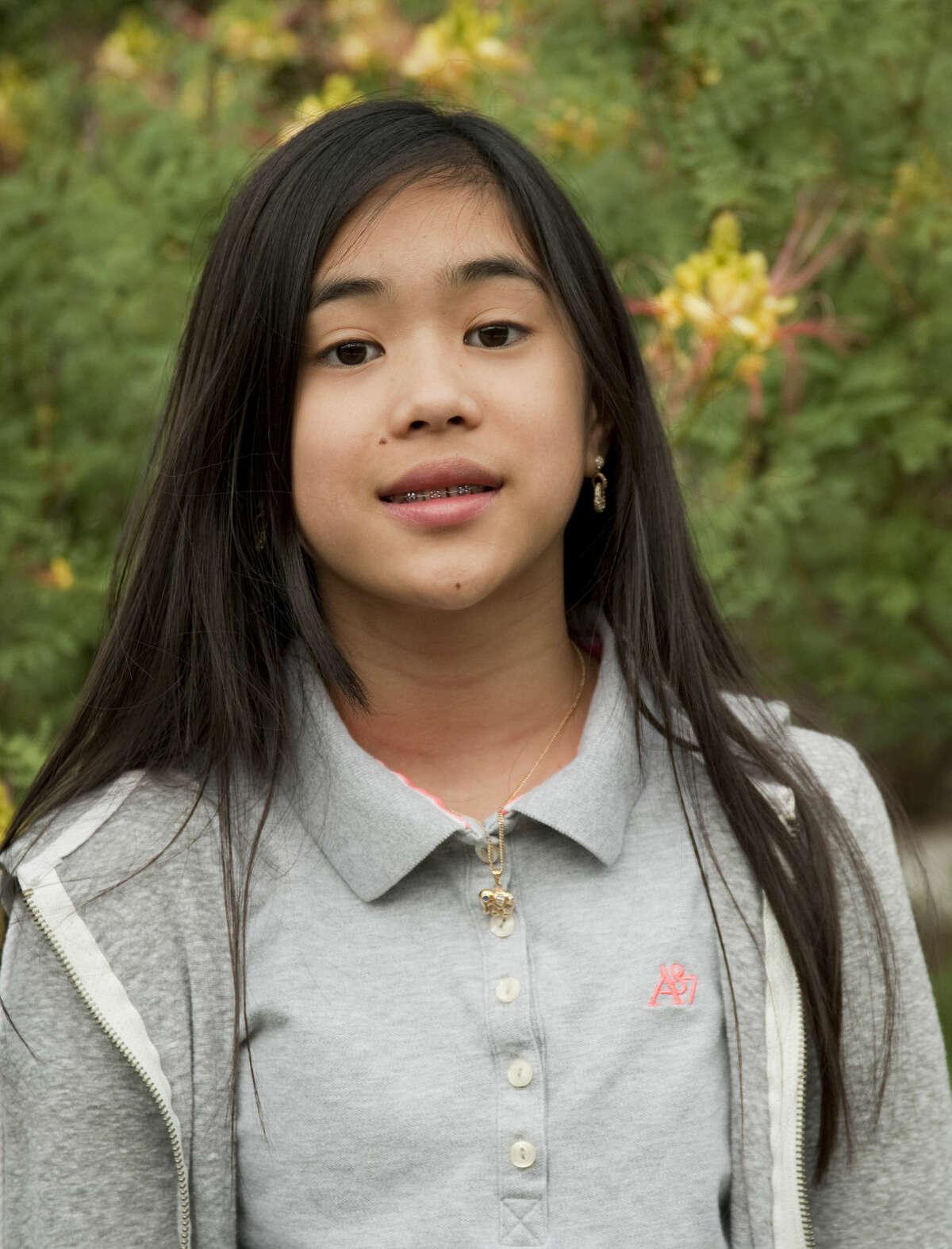 Midland Reporter-Telegram Spelling Bee winner Anna Ngo, Monday, 5-11-15, at Carver Center.