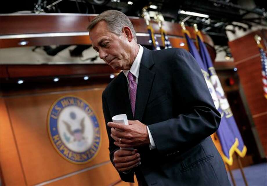 House Speaker John Boehner of Ohio wraps up a news conference on his legislative agenda, Wednesday, March 26, 2014, on Capitol Hill in Washington. Boehner touched on the Ukraine crisis, relations with Russia, the NSA surveillance program, jobs and other issues. (AP Photo/J. Scott Applewhite) Photo: J. Scott Applewhite / AP