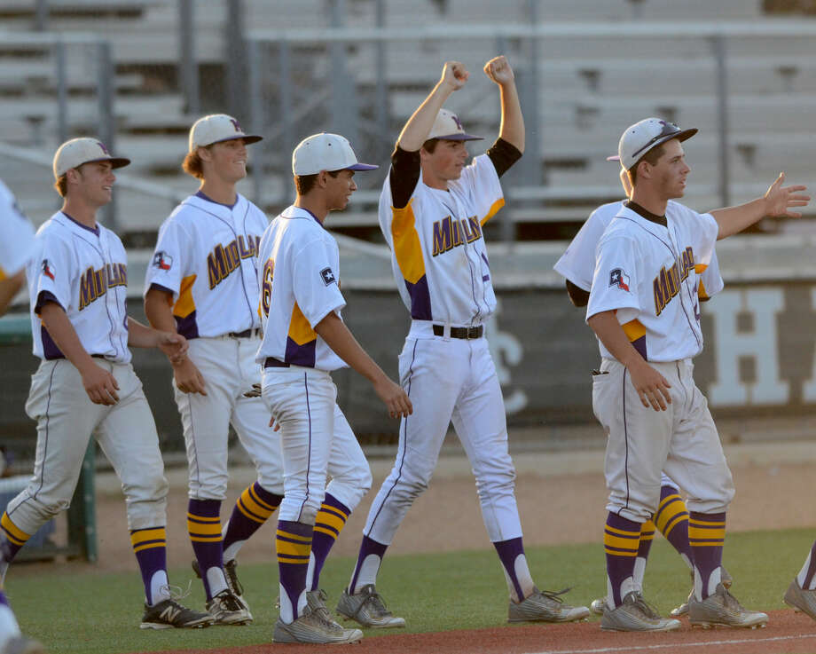 Midland High celebrates a win against Arlington Lamar in game three of the 6A bi-district playoff on Saturday, May 9, 2015 at Christensen Stadium. James Durbin/Reporter-Telegram Photo: James Durbin