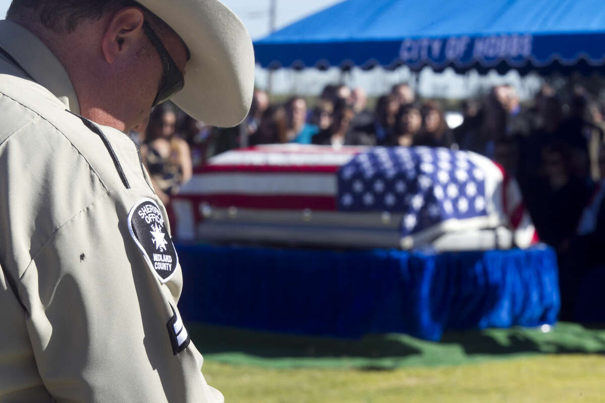 Burial ceremony for Midland County Sheriff's Dept. Sgt. Mike Naylor on Tuesday at Prairie Haven Cemetery in Hobbs, New Mexico. James Durbin/Reporter-Telegram