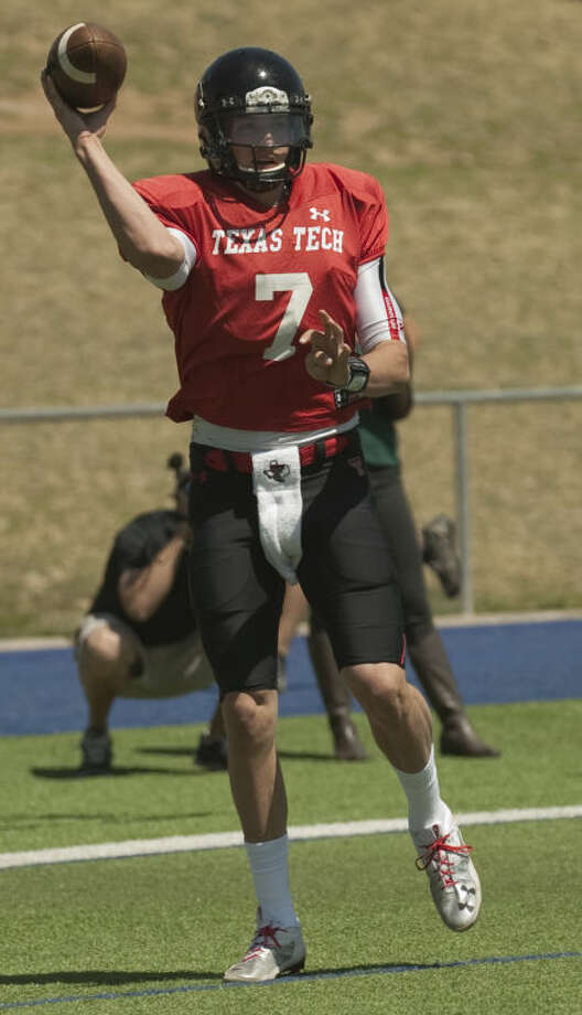 Tech's Davis Webb drops back for a pass in this March 2014 photo at the Texas Tech scrimmage at Grande Communications Stadium. Tim Fischer\Reporter-Telegram Tim Fischer\Reporter-Telegram Photo: Tim Fischer