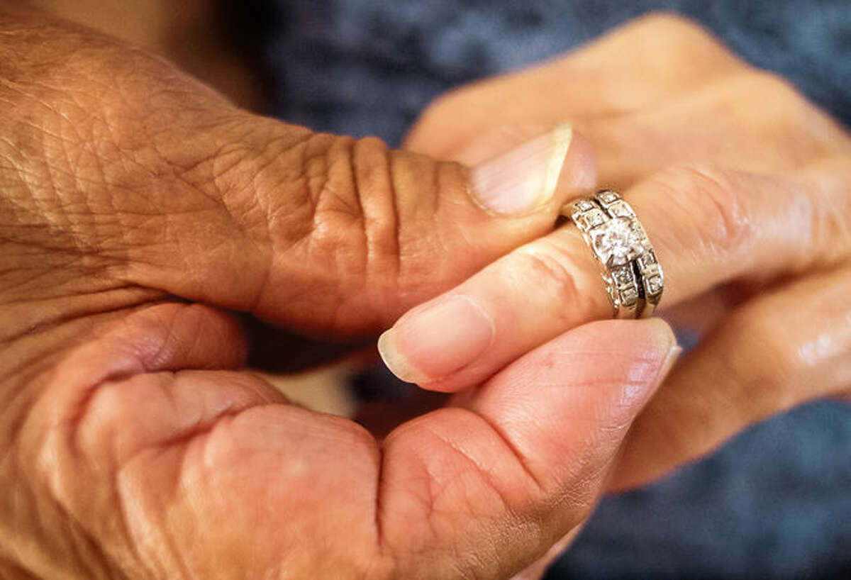 Robert Kirker puts a wedding ring -- that had been lost for 30 years -- on the hand of his wife, Ofelia, at their home in Las Cruces, N.M., on May 27.