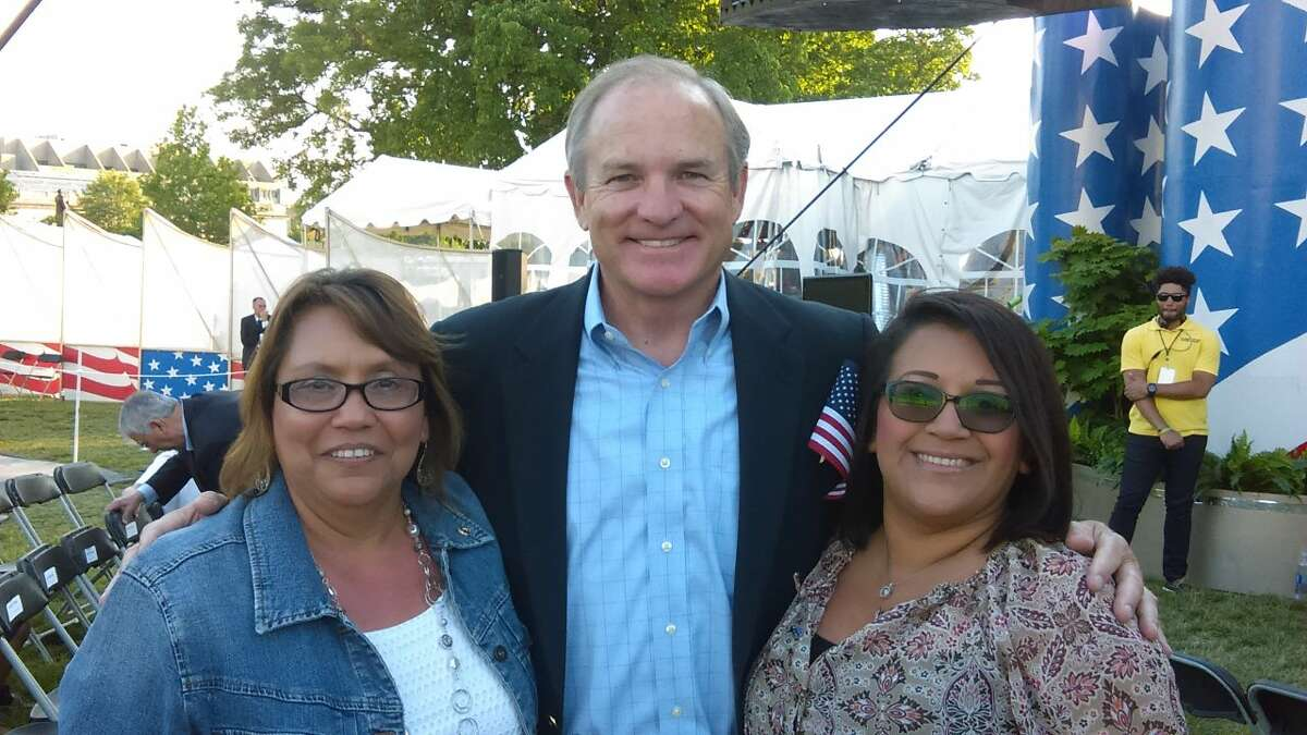 Angel Munoz, right, and her mother, Sylvia Macias, pose with Chet Edwards, former U.S. representative and senator from Texas at the Memorial Day concert.