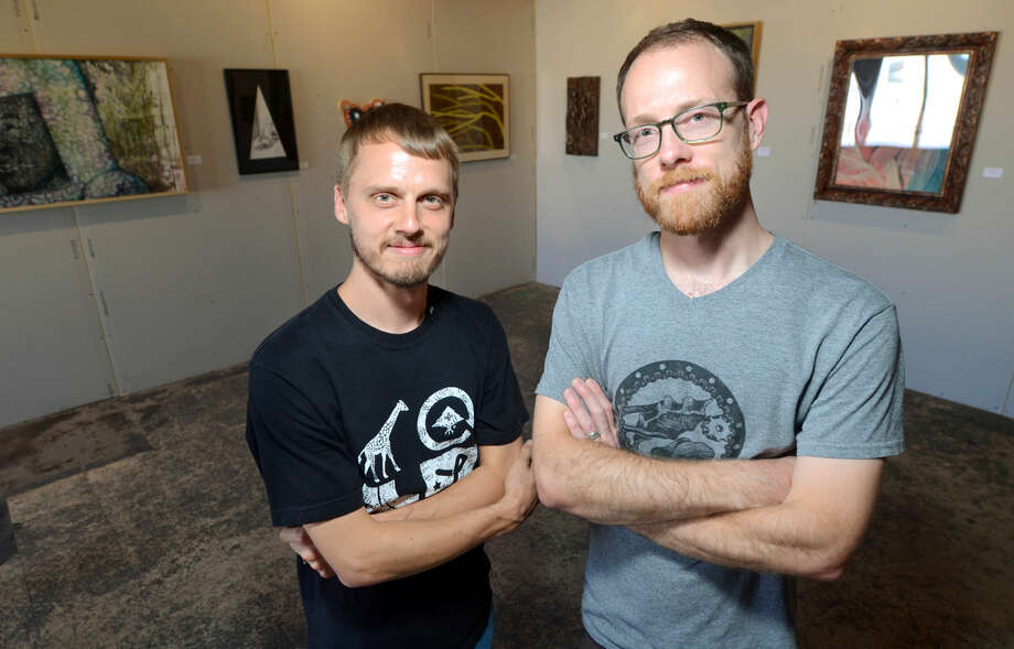 Scott and Elliott Lunson pose for a photo June 12, 2014 in the Kamiposi Gallery. James Durbin/Reporter-Telegram Photo: James Durbin