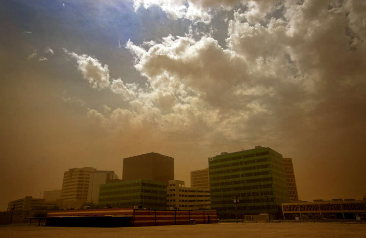 A dust storm surrounds downtown Midland on June 29, 2013.