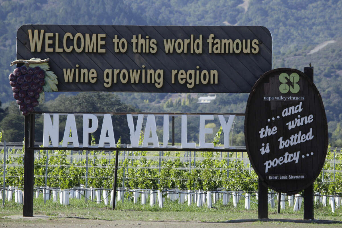 FILE - This Oct. 27, 2011, file photo shows a sign along Highway 29 welcoming visitors to the Napa Valley in Oakville, Calif. (AP Photo/Eric Risberg)