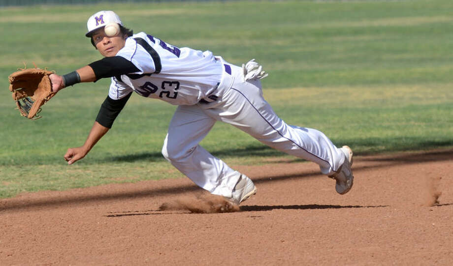 Midland High's Gilbert Sanchez makes a diving catch to end the inning against Abilene April 26, 2013 at Zachery Field. James Durbin/Reporter-Telegram Photo: JAMES DURBIN