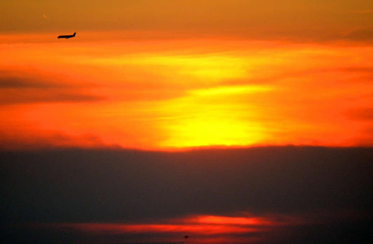 A passenger aircraft rolls into its final approach to Midland International Airport against the setting sun Friday. James Durbin/Reporter-Telegram