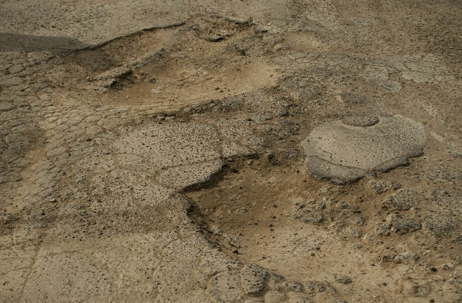 A pothole that was to be filled at the intersection of Cotton Flat and Francis in Midland.Thursday, 1-29-15. Tim Fischer\Reporter-Telegram Photo: Tim Fischer