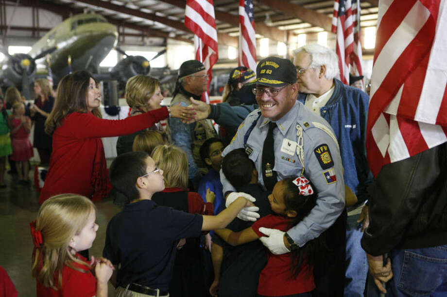 Guy Harned, a US Navy veteran, receives hugs and handshakes from Rusk Elementary students during Rusk's annual Veteran's Day program Nov. 7, 2013 at the CAF. James Durbin/Reporter-Telegram Photo: JAMES DURBIN