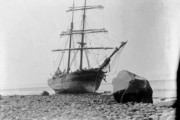 """""""The """"Tanner"""" was one of the earliest vessels to make regular trips between San Francisco and Puget Sound. In 1866, the vessel arrived in Seattle carrying some of the Mercer Girls on the last leg of their voyage from the east coast. By 1900, the days of sailing ships had passed. The """"Tanner"""" ended its days in 1902, beached and abandoned at Port Townsend, on Washington's Olympic Peninsula. This photo, taken in 1902 by James G. McCurdy, shows the old sailing ship """"Tanner"""" on the beach at Port Townsend, Washington."""" -MOHAI. Courtesy MOHAI, James G. McCurdy photograph, image number 1955.970.627."""