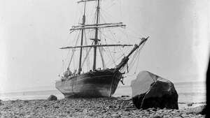 """The ""Tanner"" was one of the earliest vessels to make regular trips between San Francisco and Puget Sound. In 1866, the vessel arrived in Seattle carrying some of the Mercer Girls on the last leg of their voyage from the east coast. By 1900, the days of sailing ships had passed. The ""Tanner"" ended its days in 1902, beached and abandoned at Port Townsend, on Washington's Olympic Peninsula. This photo, taken in 1902 by James G. McCurdy, shows the old sailing ship ""Tanner"" on the beach at Port Townsend, Washington."" -MOHAI. Courtesy MOHAI, James G. McCurdy photograph, image number 1955.970.627."