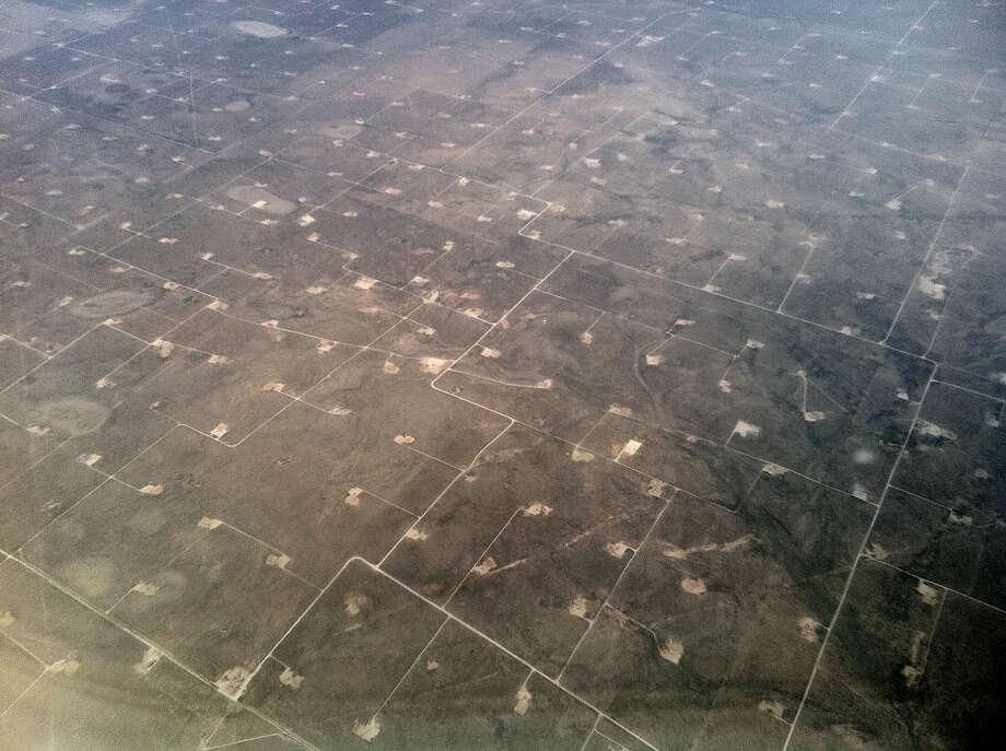 Oil wells dot the landscape as seen from the air Thursday, June 2, 2011, in Midland. ( Brett Coomer / Houston Chronicle ) Photo: Brett Coomer