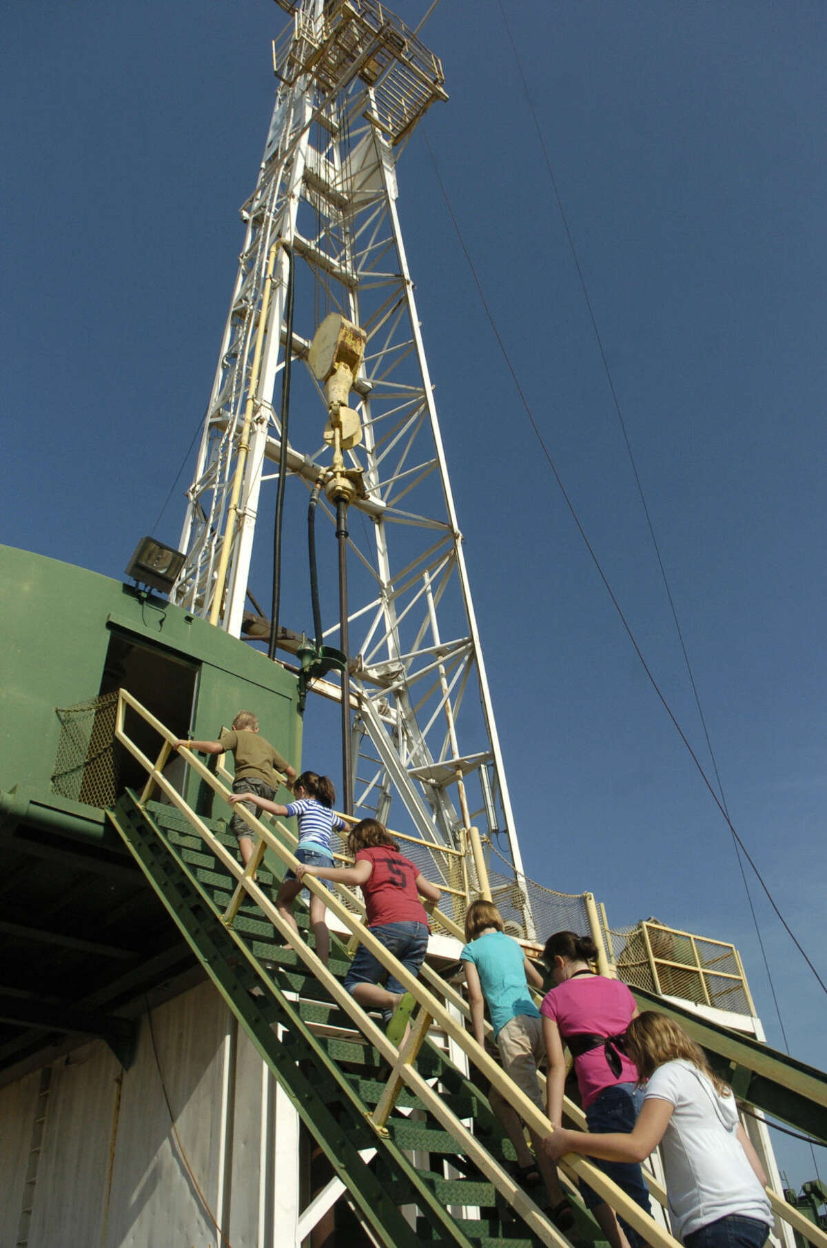 In this MRT file photo, students in the Petroleum Museum's summer camp make their way up the drilling rig at the museum to get a first hand view of how a drilling rig works. Photo by Tim Fishcer 7\24\09