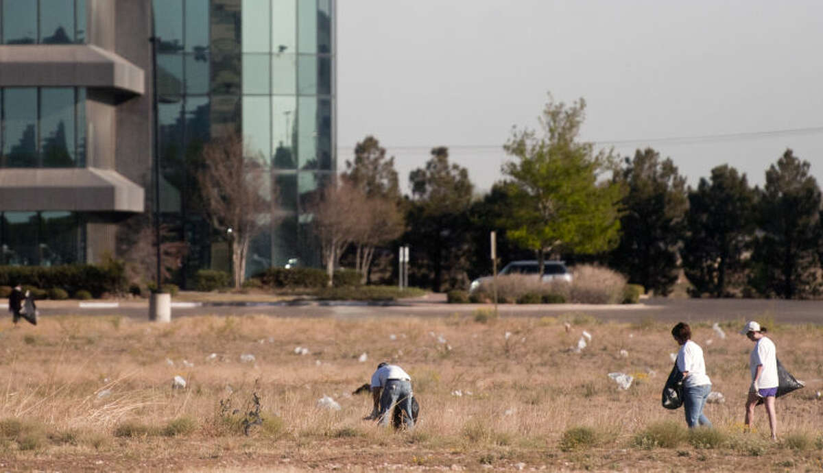 Volunteers pick up trash in a field near N. Big Spring and Wadley last year during a citywide cleanup for Keep Midland Beautiful. James Durbin/Reporter-Telegram