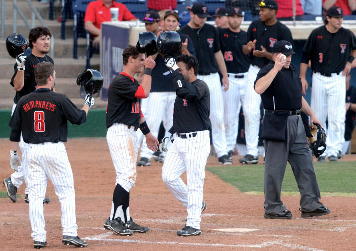 Texas Tech's Eric Gutierrez (right) is congratulated by teammates after hitting a three-run home run against New Mexico during a non-conference game Tuesday at Security Bank Ballpark. James Durbin/Reporter-Telegram