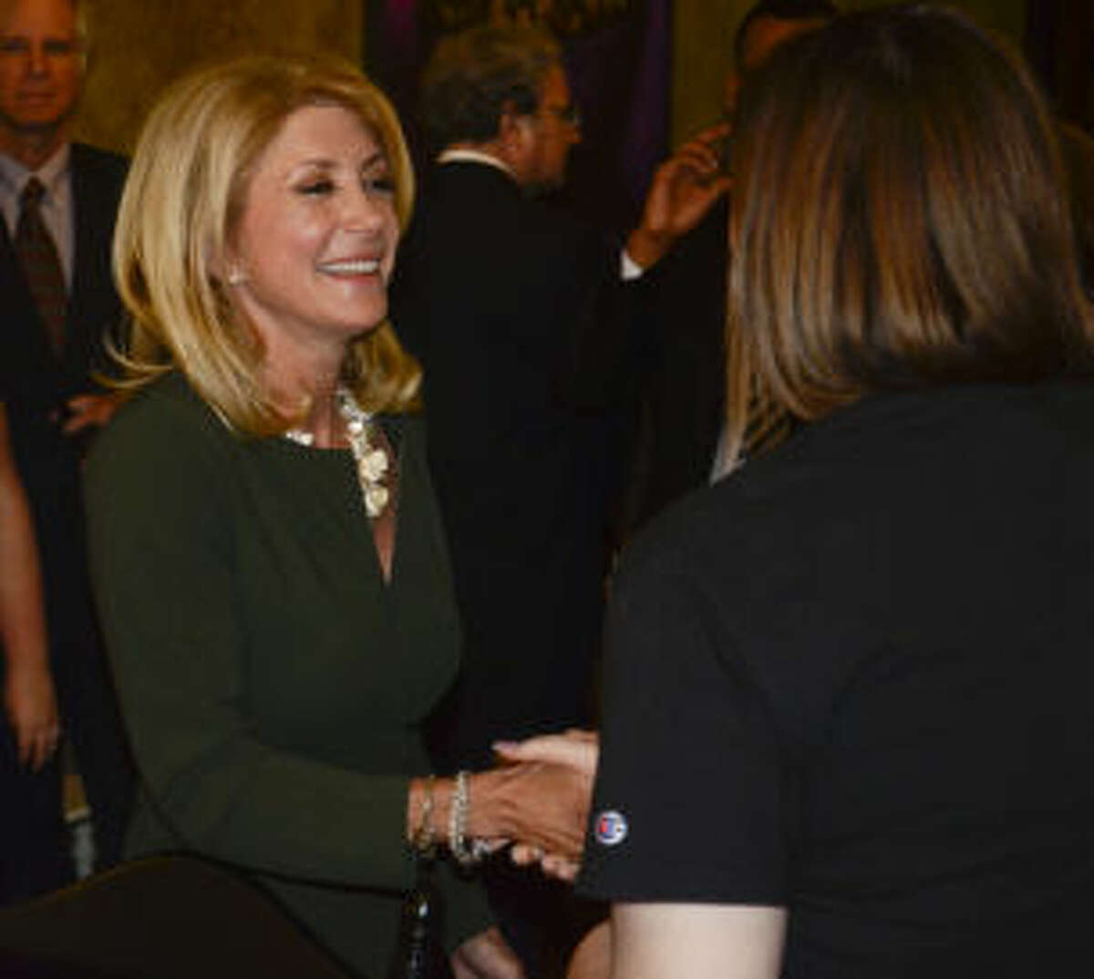Wendy Davis, Democrat running for governor, talks with area supporters Wednesday morning at a meet and greet at Harvest Cafe in Midland. Tim Fischer\Reporter-Telegram