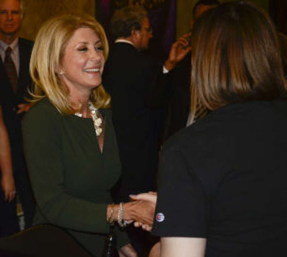 Wendy Davis, Democrat running for governor, talks with area supporters Wednesday morning at a meet and greet at Harvest Cafe in Midland. Tim Fischer\Reporter-Telegram Photo: Tim Fischer