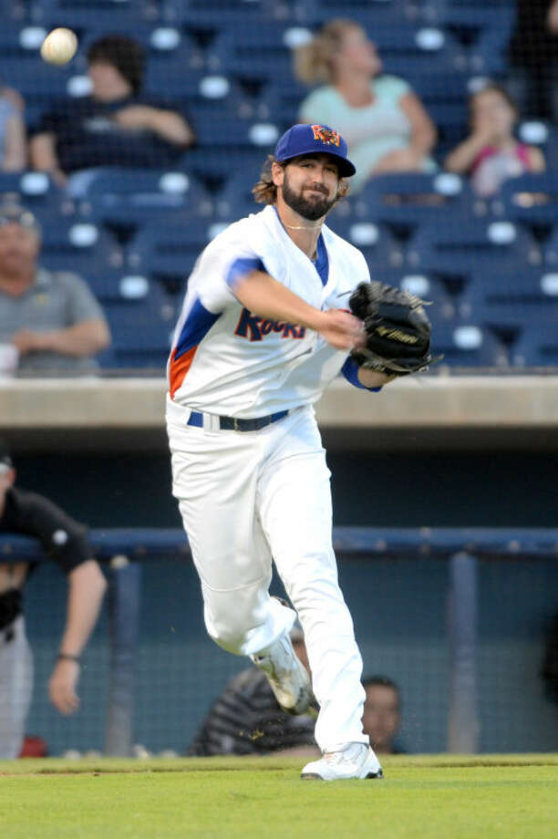 Rockhounds pitcher Drew Granier throws to first base during the game against San Antonio Missions last August at Citibank Ballpark. James Durbin/Reporter-Telegram Photo: JAMES DURBIN