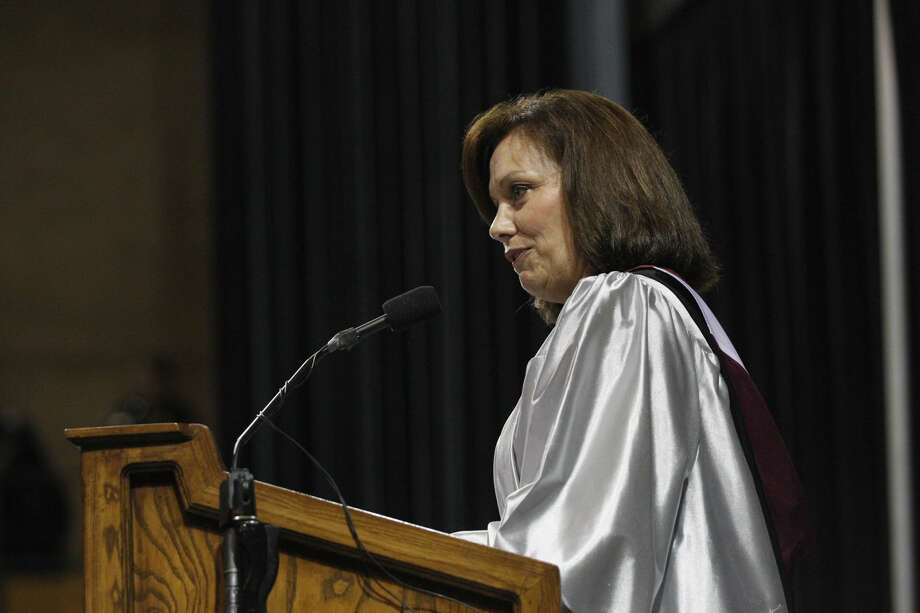 Lee High School principal Jeanette McNeely speaks during the 2014 Lee High graduation ceremony. McNeely has resigned her position for a job in Weatherford. Photo: File Photo