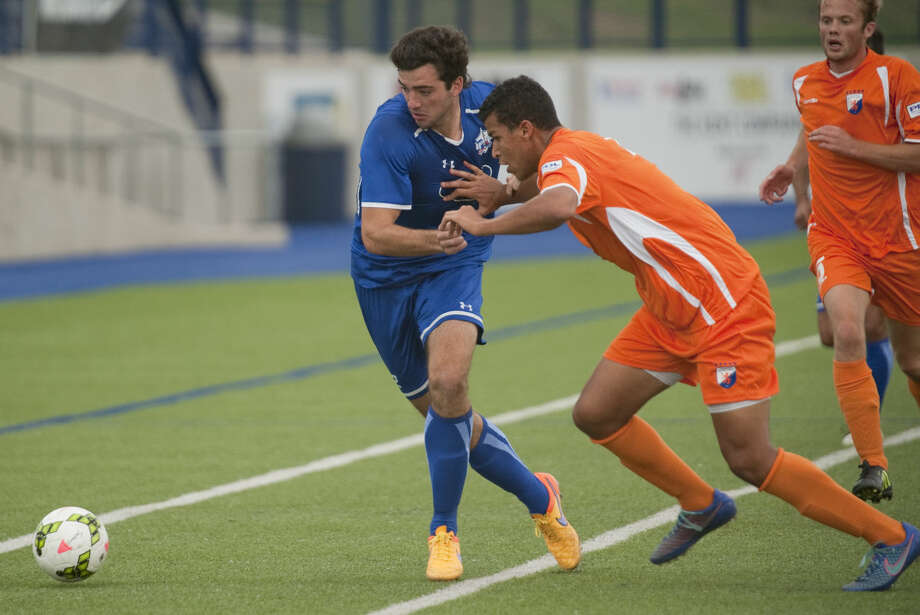 Sockers' Tucker Hume and Houston Dutch's Marshal Tucker fight for the ball Thursday, 6-4-15, at Grande Communications Satdium. Tim Fischer\Reporter-Telegram Photo: Tim Fischer