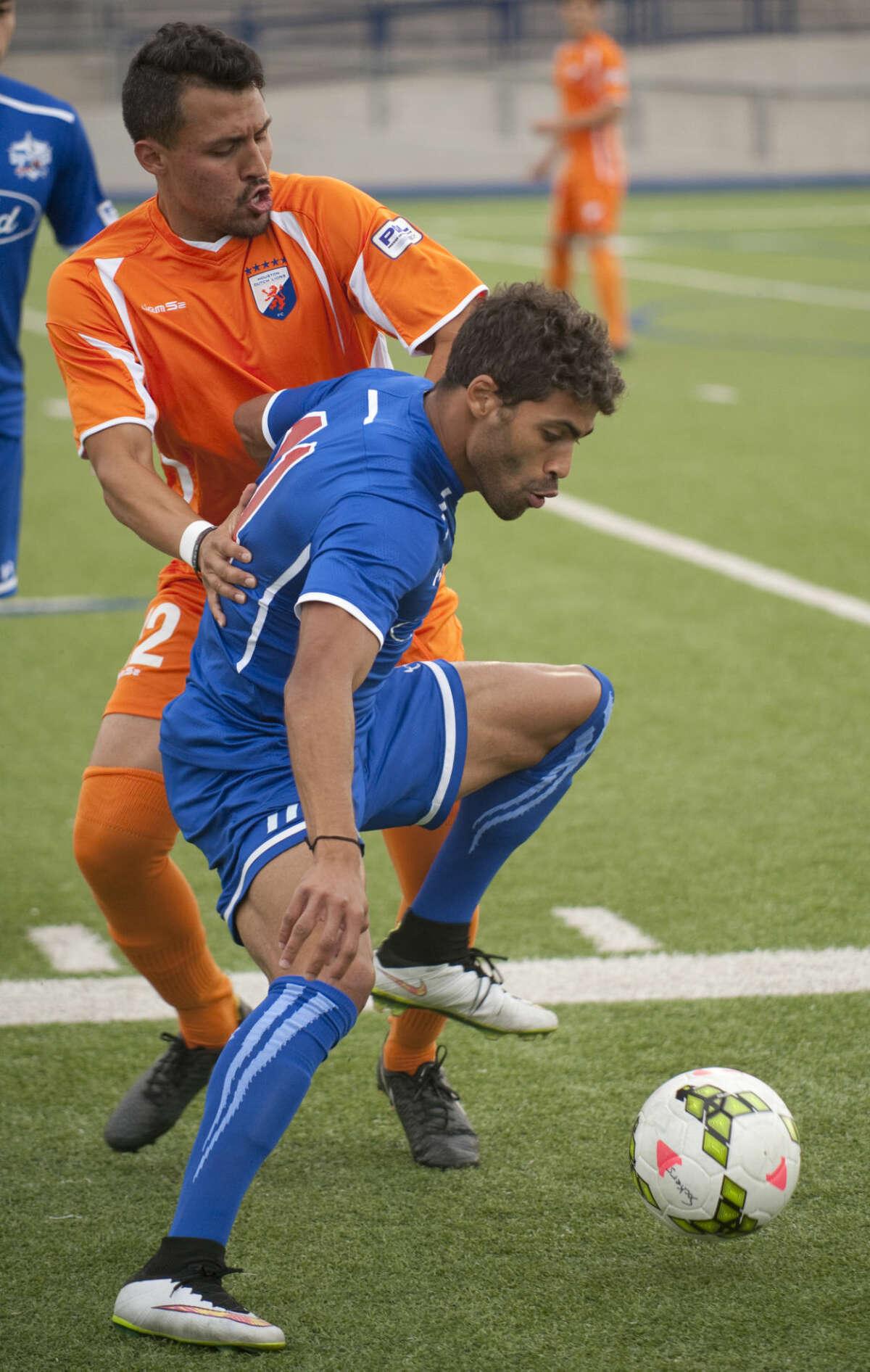 Sockers' Fabio Pena tries to shield the ball from Houston Dutch's David Perez Thursday, 6-4-15, at Grande Communications Satdium. Tim Fischer\Reporter-Telegram
