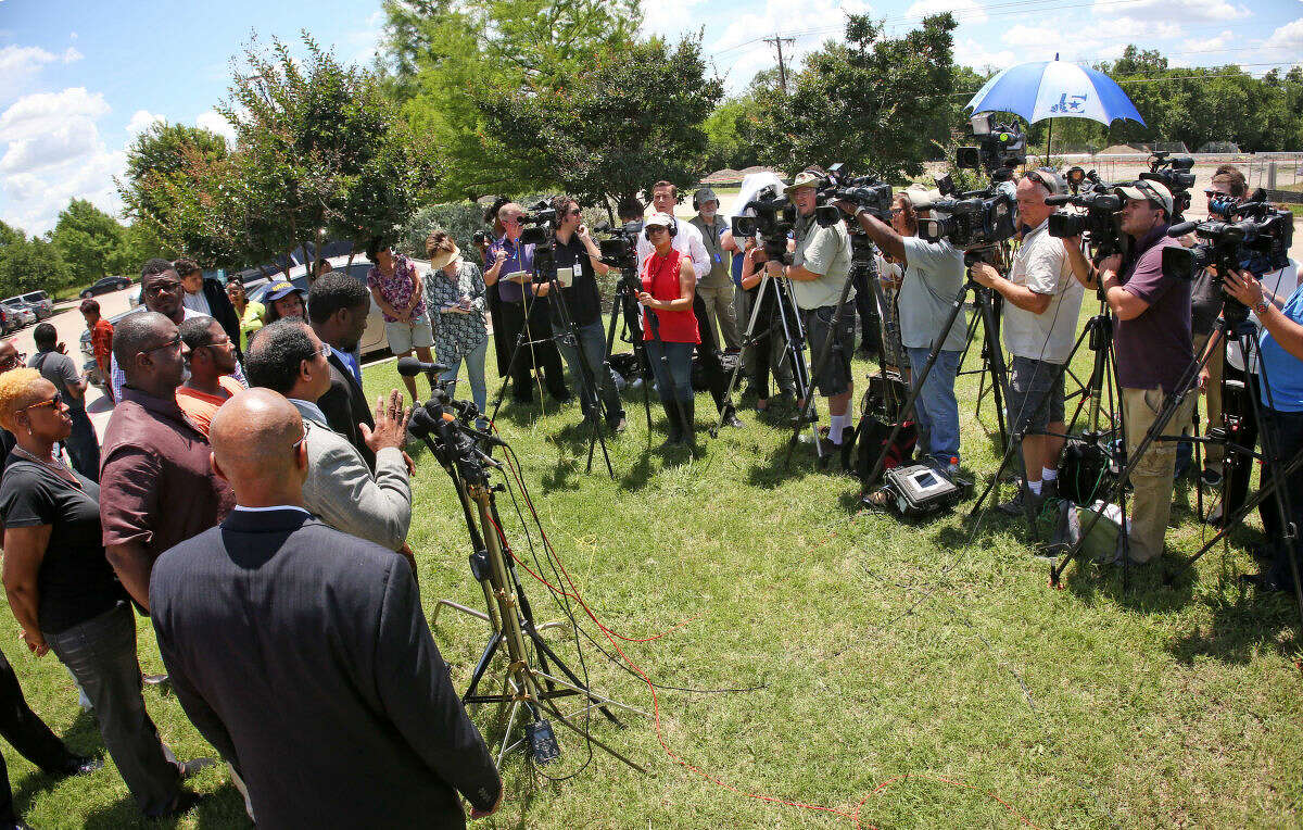 Community leaders speak during a news conference outside the McKinney Police Department headquarters, Monday, June 8, 2015, in McKinney, Texas. A McKinney police officer has been placed on leave after a video showed him pushing a 14-year-old girl to the ground outside a pool and pointing his gun at other black teens. (Louis DeLuca/The Dallas Morning News via AP)