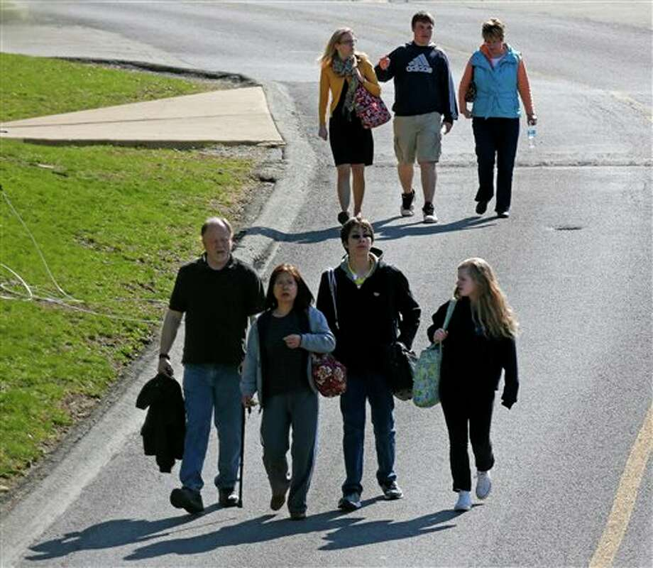 Students are escorted from the campus of the Franklin Regional School District after more then a dozen students were stabbed by a knife wielding suspect at nearby Franklin Regional High School on Wednesday, April 9, 2014, in Murrysville, Pa., near Pittsburgh. The suspect, a male student, was taken into custody and is being questioned. (AP Photo/Gene J. Puskar) Photo: Gene J. Puskar / AP
