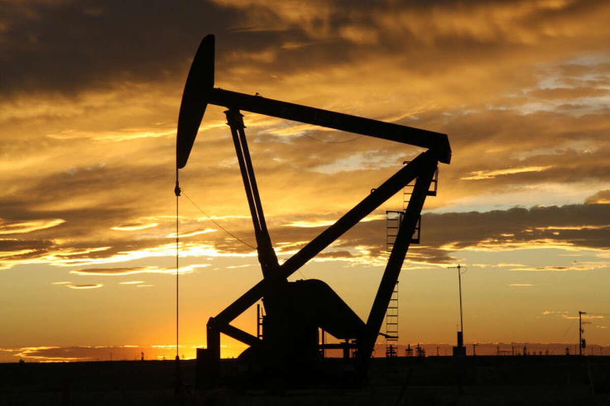 The sun set on the oil field.