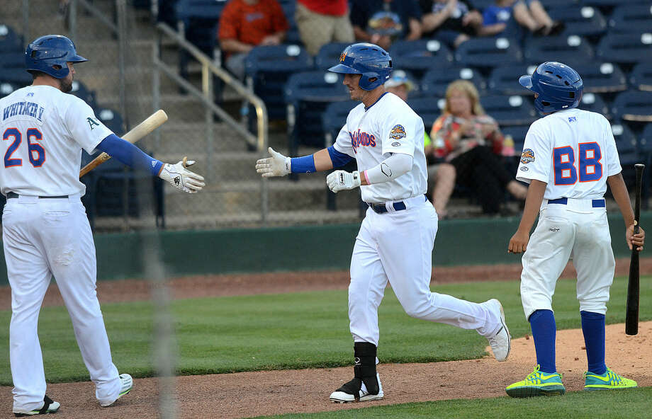 Rockhounds' Colin Walsh is congratulated by teammates after hitting a home run against Corpus Christi on Tuesday, June 9, 2015, at Security Bank Ballpark. James Durbin/Reporter-Telegram Photo: James Durbin